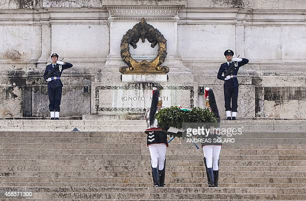Italian corazzieri members of the Italian Presidential Republic Honour Guard lay a laurel wreath at the Altare della Patria during Italy's National...