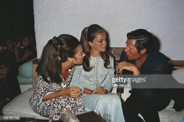 Italian countess Consuelo Crespi and Italian actor Marcello Mastroianni in conversation with a third woman in Costa Smeralda Sardinia Italy in August...