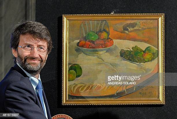 Italian Culture minister Dario Franceschini stands next to to the painting by French artists Paul Gauguin 'Fruits sur une table ou nature morte au...