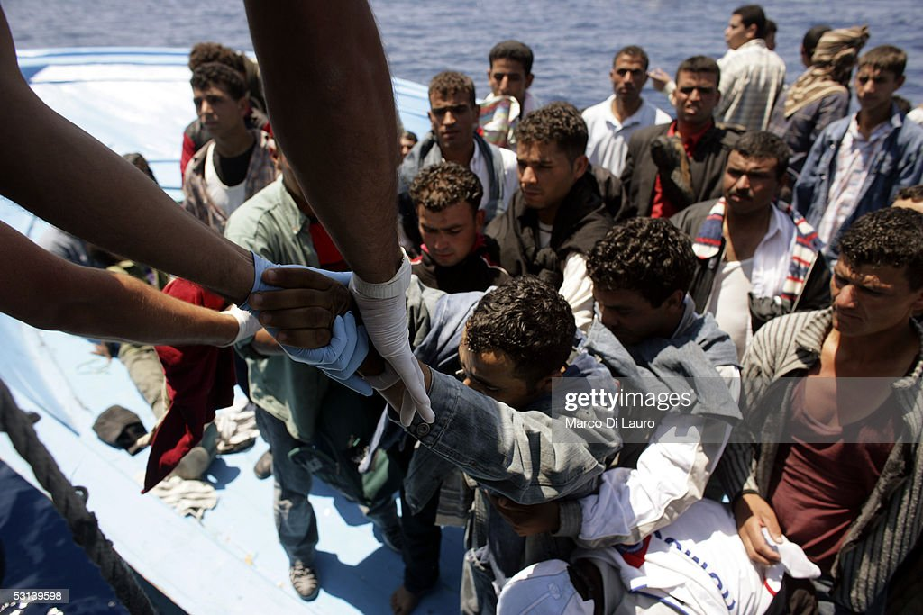 Italian custom Police 'Guardia di Finanza' Officers take on board illegal Immigrants on June 21 2005 in Lampedusa Italy Tens of thousands of...
