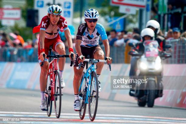 Italian cyclist Domenico Pozzovivo of AG2R La Mondiale Team and Russian cyclist Ilnur Zakarin of Katusha Alpecin team cross the finish line at the...