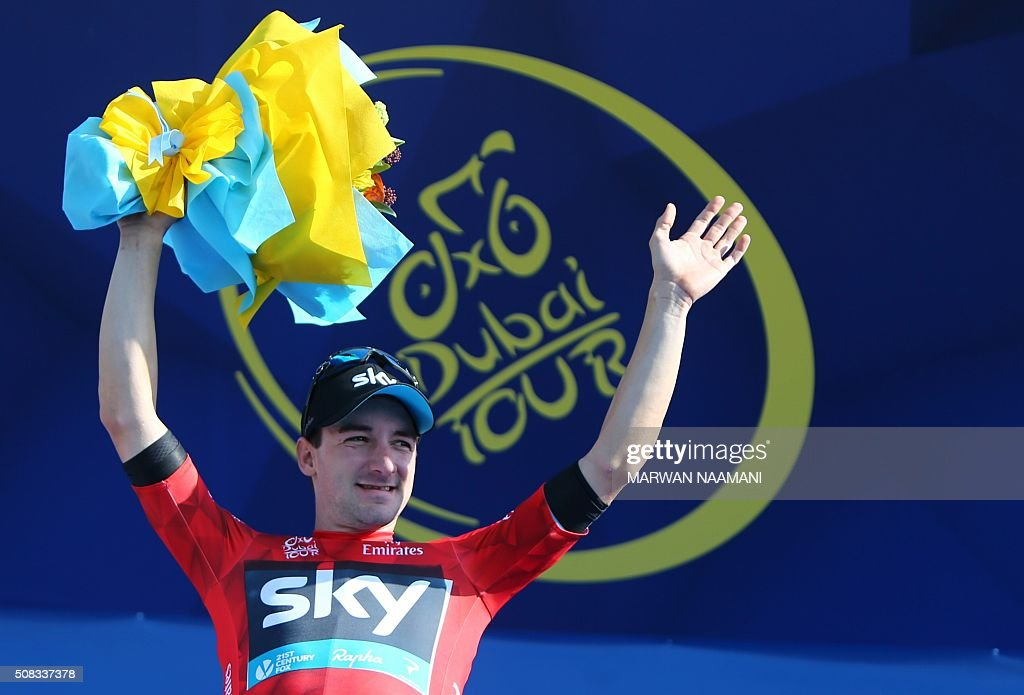 Italian Cyclist Elia Viviani of Team SKY jubilates in his red jersey on the podium after winning the second stage of Dubai Tour 2016 in Dubai on February 4, 2016. Italy's Elia Viviani, riding for Team Sky, sprinted to victory in the second stage of the Tour of Dubai and grabbed the leader's blue jersey from Germany's Marcel Kittel. Viviani had benefitted from a crash in the final kilometre that appeared to affect opponents. NAAMANI