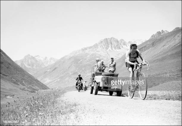 Italian cyclist Fausto Coppi rides uphill in the Col du Galibier on July 6 during the 11th stage of the Tour de France between Bourg d'Oisans and...