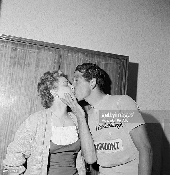 Italian cyclist Gastone Nencini kissing his wife Bianca wearing the pink jersey got by winning at Giro d'Italia 1957 Milan June 1957