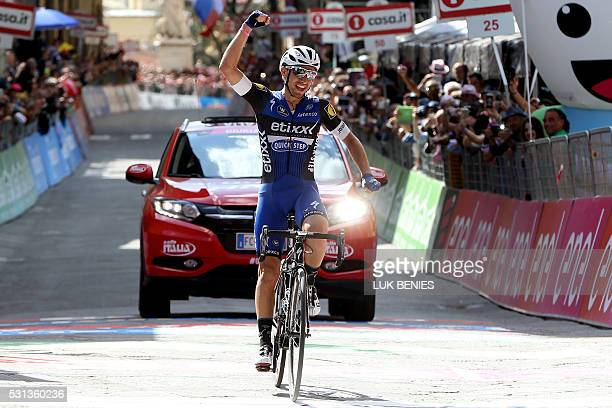 Italian cyclist Gianluca Brambilla of Etixx Quick Step team raises his arms as he crosses the finish line and wins the 8th stage of 99th Giro...