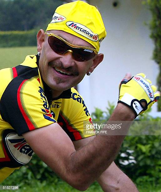 Italian cyclist Marco Pantani participates in the 156 kilometer 15th stage of the Tour of Italy in Conegliano 28 May 2002 Italy's Marco Cipollini...
