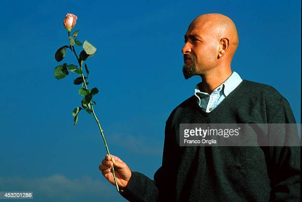 Italian cyclist Marco Pantani Tour de France and Giro d'Italia race winner in 1998 holds a rose as a symbol of the Giro d'Italia race at the...