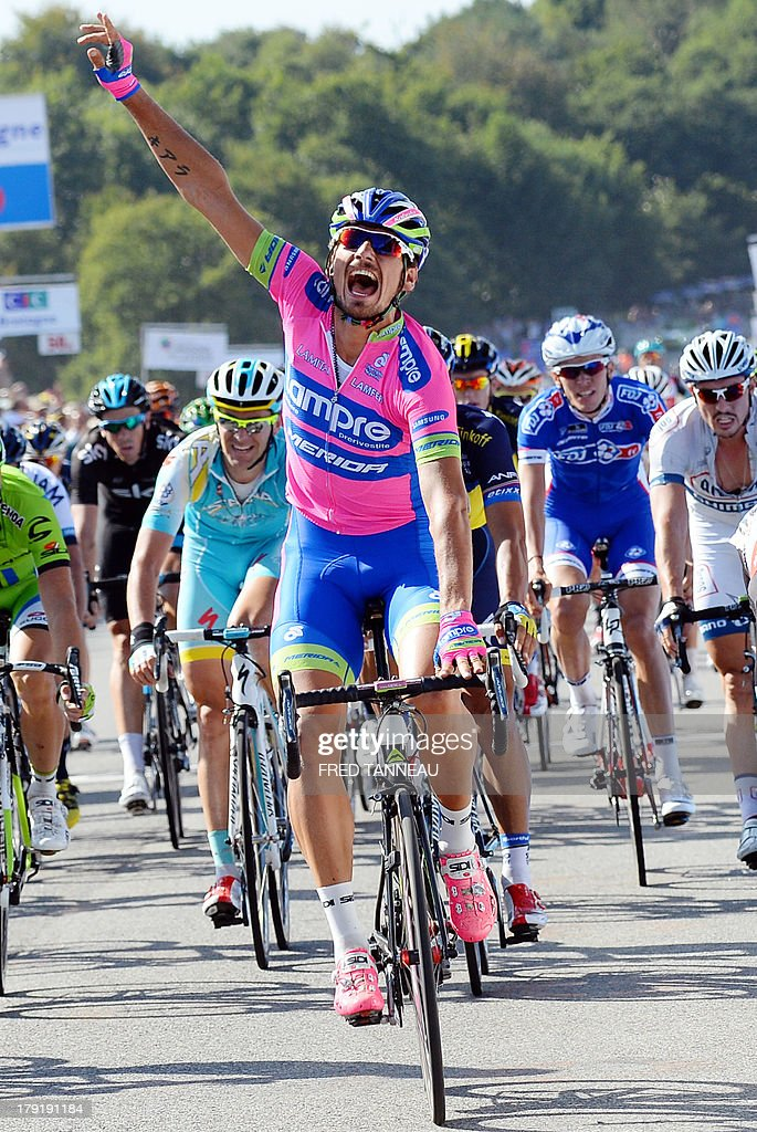 Italian cyclist of the Lampre-Merida team Filippo Pozzato celebrates as he crosses the finish line and wins the 77th edition of the Grand Prix of Plouay, on September 1, 2013 in Plouay, western France.