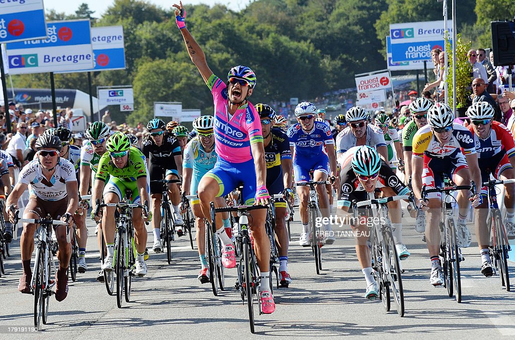 Italian cyclist of the Lampre-Merida team Filippo Pozzato celebrates as he crosses the finish line and wins the 77th edition of the Grand Prix of Plouay, on September 1, 2013 in Plouay, western France. AFP PHOTO/FRED TANNEAU