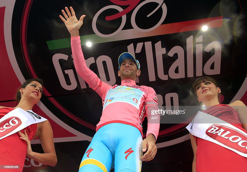 Italian cyclist <a gi-track='captionPersonalityLinkClicked' href=/galleries/search?phrase=Vincenzo+Nibali&family=editorial&specificpeople=770634 ng-click='$event.stopPropagation()'>Vincenzo Nibali</a> (C) celebrates on the podium with the pink jersey after the 170 km 9th stage of 96th Giro d'Italia from Sansepolcro to Florence on May 12, 2013, in Florence.