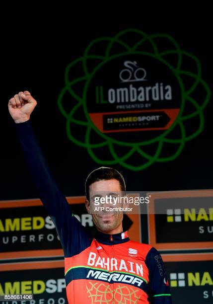 Italian cyclist Vincenzo Nibali from BahreinMerida team celebrates on the podium during the price ceremony after winning the 111th edition of The...