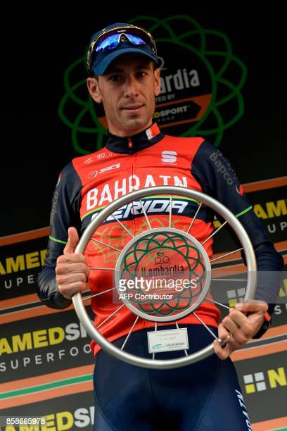 Italian cyclist Vincenzo Nibali from BahreinMerida team celebrates with the trophy on the podium during the price ceremony after winning the 111th...
