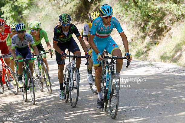 Italian cyclist Vincenzo Nibali of Astana Pro team followed by Spanish Alejandro Valverde of Movistar team in action in the climb on the dirt road...