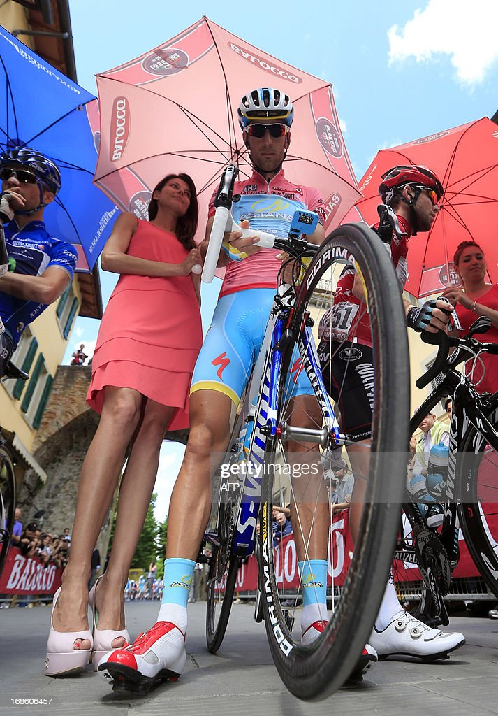 Italian cyclist <a gi-track='captionPersonalityLinkClicked' href=/galleries/search?phrase=Vincenzo+Nibali&family=editorial&specificpeople=770634 ng-click='$event.stopPropagation()'>Vincenzo Nibali</a> (C) prepares before the start of the 170 km 9th stage of 96th Giro d'Italia from Sansepolcro to Florence on May 12, 2013, in Florence.
