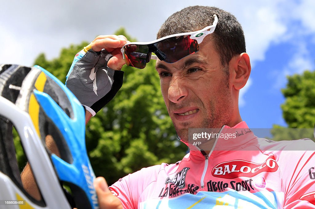 Italian cyclist <a gi-track='captionPersonalityLinkClicked' href=/galleries/search?phrase=Vincenzo+Nibali&family=editorial&specificpeople=770634 ng-click='$event.stopPropagation()'>Vincenzo Nibali</a> prepares before the start of the 170 km 9th stage of 96th Giro d'Italia from Sansepolcro to Florence on May 12, 2013, in Florence.