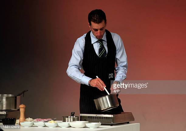 Italian cyclist Vincenzo Nibali takes part in a kitchen test during the presentation of the 96th Giro d'Italia 2013 route on September 30 in Milan...