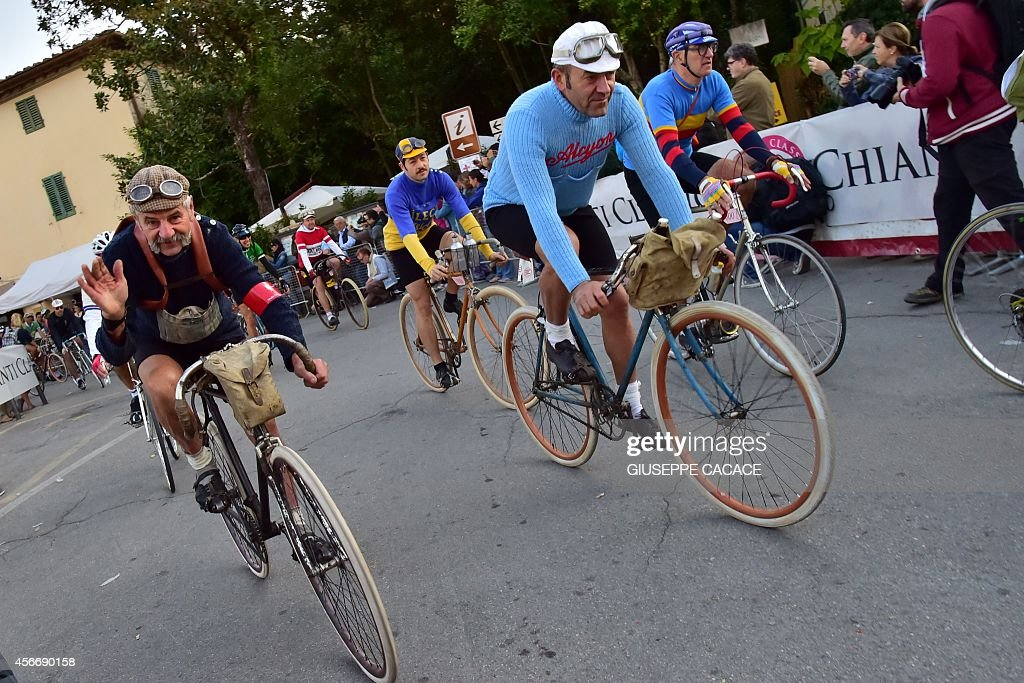 Italian cyclist wearing the number 1 bip Luciano Berruti takes part part in L'Eroica a retro cycling event on October 5 2014 in Gaiole in Chianti...