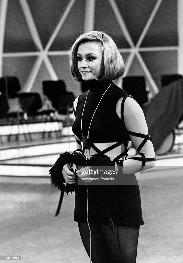 Italian dancer and presenter Raffaella Carrà in miniskirt and bare tummy in the study of the TV musical contest Canzonissima. Rome, Teatro delle Vittorie, 1970.