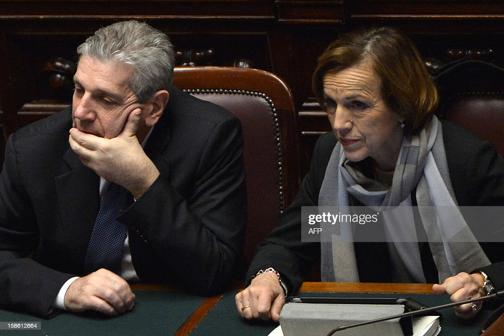 Italian defence minister Giampaolo Di Paola (L) and labour minister Elsa Fornero take place for a session on a key budget vote on December 21, 2012 at the parliement in Rome. The Italian parliament prepared Friday for a key budget vote which will trigger the resignation of Prime Minister Mario Monti, who is expected to reveal this weekend whether he will run in the upcoming election.