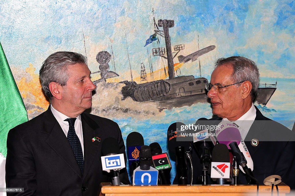 Italian Defence Minister Giampaolo di Paola (L) and Libya's Defense Minister Mohammed al-Barghathi (R) give a joint press conference on February 6, 2013 at a Libyan Navy Base during a ceremony for the hand over 20 military vehicles to Libya in Tripoli.