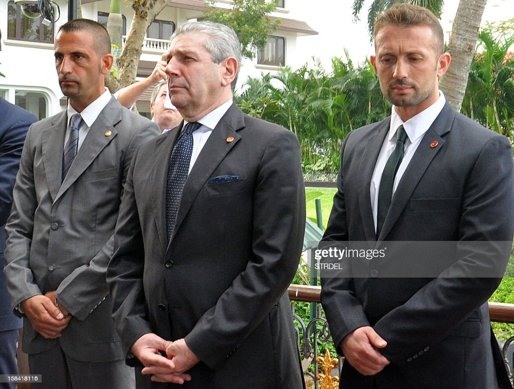 Italian Defence Minister Giampaolo Di Paolo (C) is pictured with Italian Marines Massimiliano Latorre (L) and Salvatore Girone (R), who are currently forced to stay in the city under conditional bail for charges of murdering two Indian fishermen, during his visit to Kochi on December 16, 2012. Italy's defence minister on December 16 visited two Italian marines awaiting trial in India on charges of murdering two fishermen, and appealed for the men to be allowed home for Christmas.