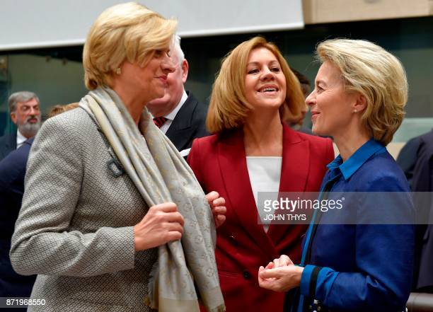 Italian Defence Minister Roberta Pinotti talks with Spanish Minister of Defence Maria Dolores de Cospedal and German Defence Minister Ursula von der...