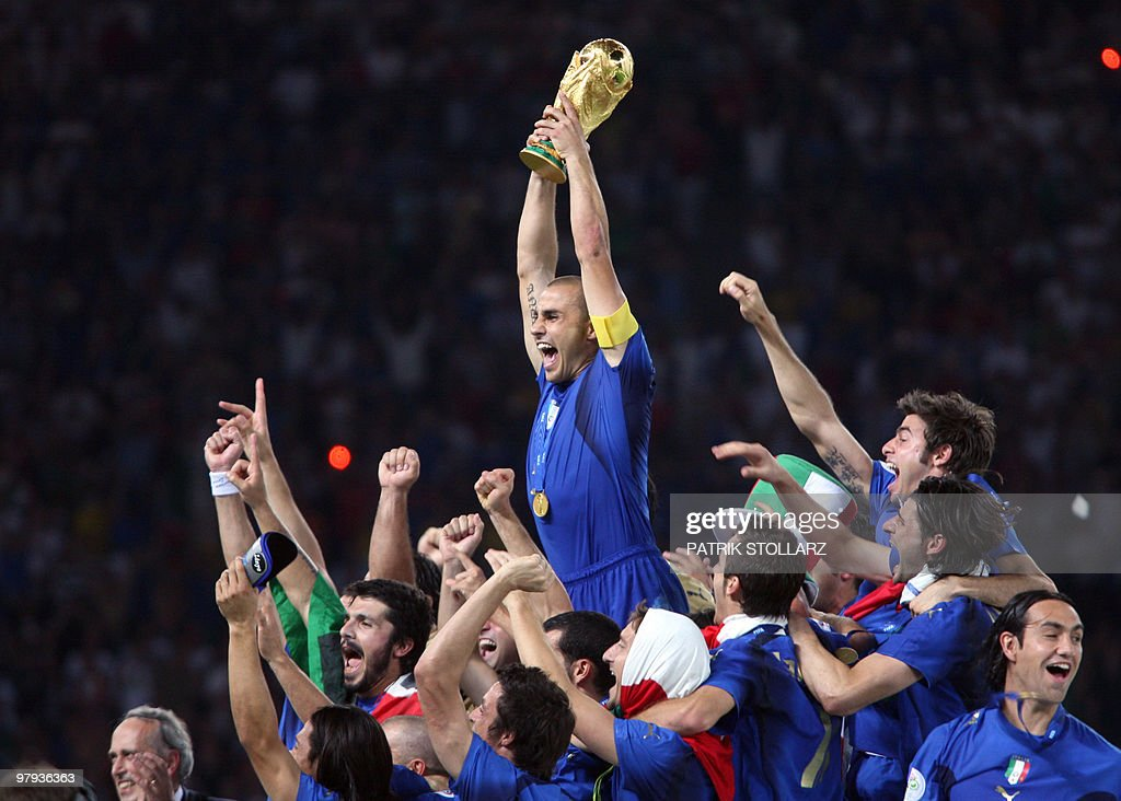 Italian defender Fabio Cannavaro celebrates with the trophy after the World Cup 2006 final football game Italy vs.France, 09 July 2006 at Berlin stadium. Italy won the 2006 football World Cup by defeating France on penalties.
