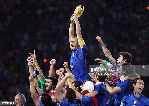 Italian defender Fabio Cannavaro celebrates with the trophy after the World Cup 2006 final football game Italy vsFrance 09 July 2006 at Berlin...