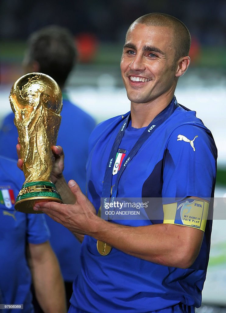 Italian defender Fabio Cannavaro waves the trophy after the World Cup 2006 final football game Italy vs.France, 09 July 2006 at Berlin stadium. Italy won the 2006 football World Cup by defeating France on penalties.