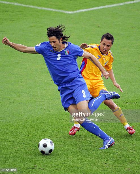 Italian defender Fabio Grosso is challenged by Romanian mildfielder Florentin Petre during the Euro 2008 Championships Group C football match Italy...