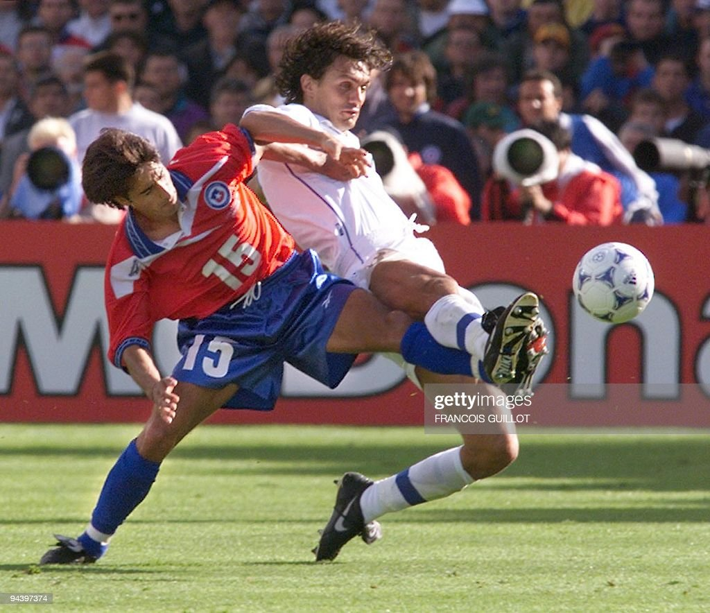 Italian defender Paolo Maldini is challenged by Chilean midfielder Moises Villaroel 11 June at Parc Lescure stadium in Bordeaux during the 1998...