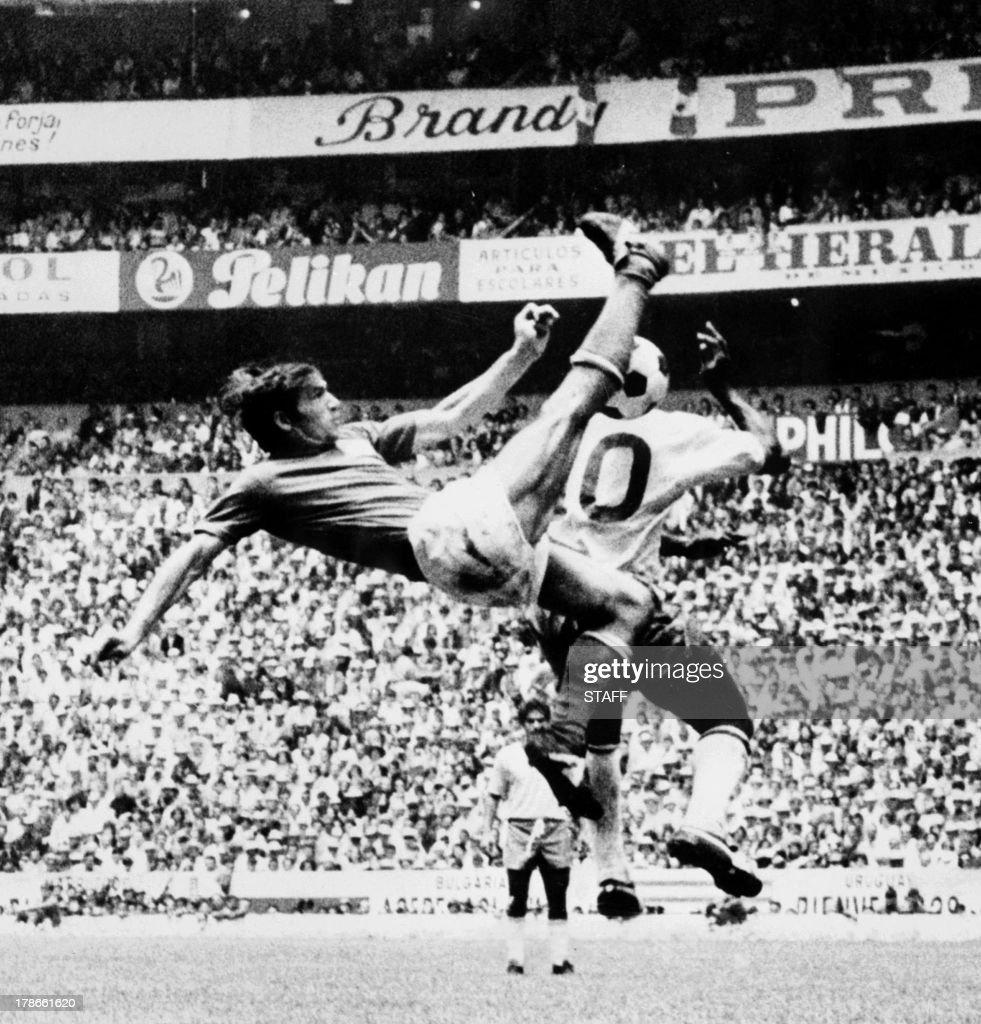 Italian defender Tarcisio Burgnich L kicks the ball away from