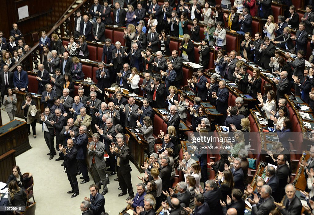 Italian Deputies and Senators applaud in the Italian Parliament in Rome on April 20, 2013 after Italian President Giorgio Napolitano was confirmed re-elected. Italy's 87-year-old President Giorgio Napolitano said on Saturday said he would run for a second term despite earlier ruling out the prospect, following an appeal from the main parties to help defuse an increasingly tense political crisis. 'I consider it necessary to offer my availability,' Napolitano said in a statement, as bickering lawmakers prepared for a sixth round of voting in parliament that he is now expected to win by a large margin.