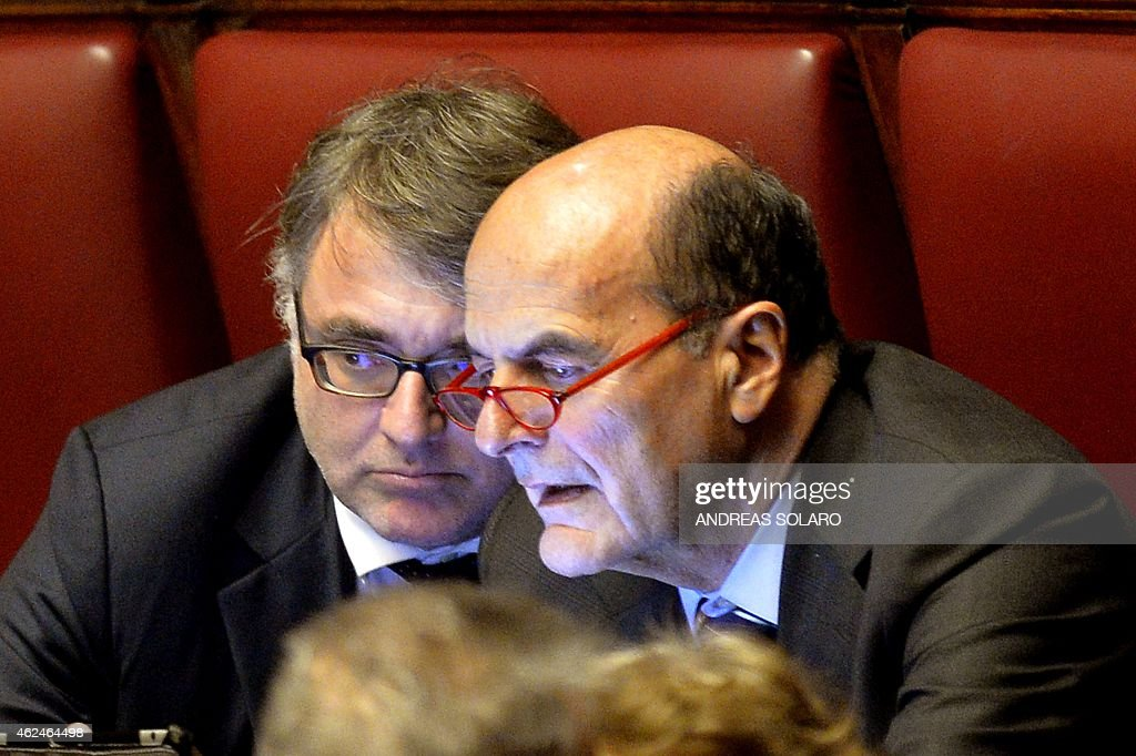 Italian deputies of the Democratic Party Miguel Gotor and Pier Luigi Bersani look at a screen at the Italian Parliament in Rome on January 29 during...