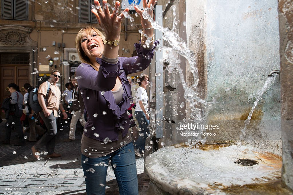 Italian deputy <a gi-track='captionPersonalityLinkClicked' href=/galleries/search?phrase=Alessandra+Mussolini&family=editorial&specificpeople=243183 ng-click='$event.stopPropagation()'>Alessandra Mussolini</a> splashing with the water of a fountain. Rome, 27th April 2012.