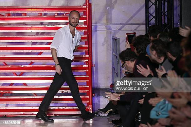 Italian designer Aldo Maria Camillo for Cerruti 1881 acknowledges the public during the Fall/Winter 20142015 men's fashion show in Paris on January...