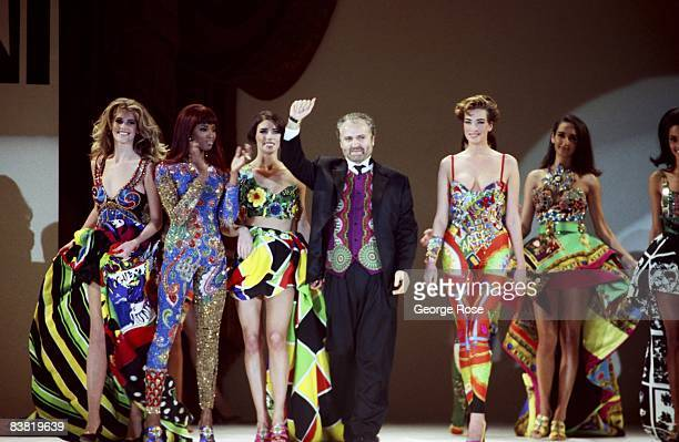Italian designer and toast of Paris Miami and New York Gianni Versace takes a bow at a 1991 Los Angeles California fashion show