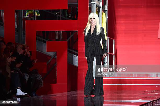 Italian designer Donatella Versace acknowledges the audience at the Versace show during the Milan Fashion Week Autumn/Winter 2015 on February 27 2015...