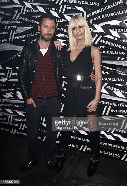 Italian designer Donatella Versace and Versuss creative director Anthony Vaccarello arrive for the launch party of Versace's diffusion label at the...