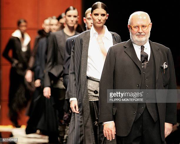 Italian designer Gianfranco Ferre walks on the catwalk with models after showing his Fall/Winter 2005/2006 collection in Milan 25 February 2005 AFP...