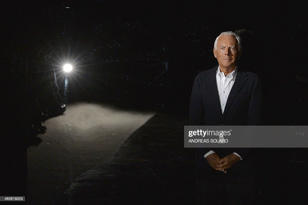 Italian designer Giorgio Armani acknowledges the audience at the end of his show as part of Autumn/Winter 2014 Milan Collections during the Men's...