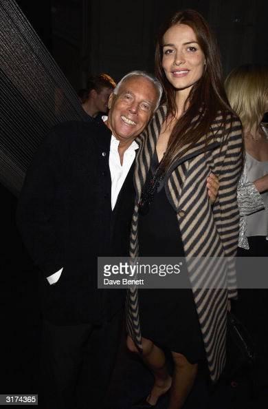 Italian designer Giorgio Armani and British model Saffron Burrows attends the cocktail party to celebrate 'Giorgio Armani Retrospective' at the Royal...