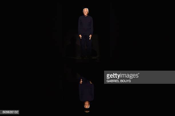 TOPSHOT Italian designer Giorgio Armani greets the audience at the end of his show during the Men Fall Winter 2016 / 2017 collection shows at the...
