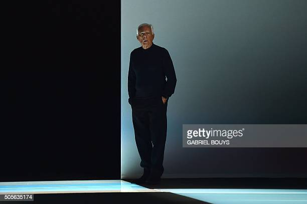 Italian designer Giorgio Armani is pictured before his show during the Men Fall Winter 2016 / 2017 collection shows at the Milan's Fashion Week on...