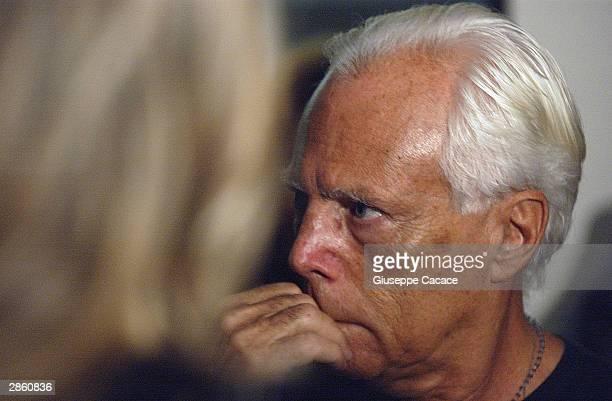 Italian designer Giorgio Armani looks on during the presentation of his book 'Faces of Sport' January 11 2004 in Milan Italy Giorgio Armani announced...