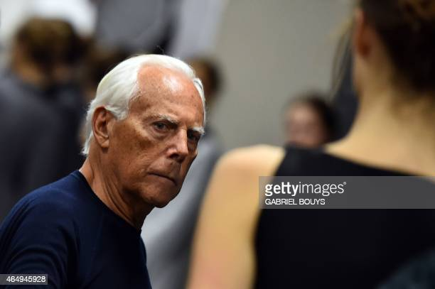 Italian designer Giorgio Armani works backstage before his show at the women Fall / Winter 2015/16 Milan's Fashion Week on March 2 2015 AFP PHOTO /...
