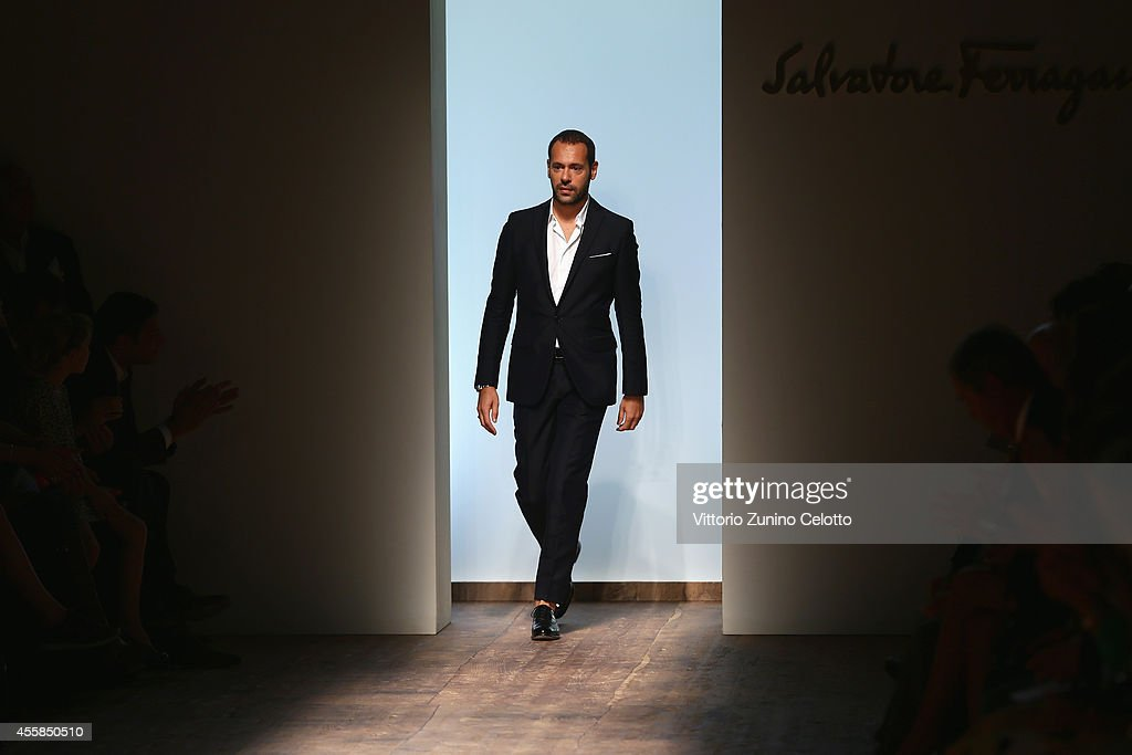 Italian designer <a gi-track='captionPersonalityLinkClicked' href=/galleries/search?phrase=Massimiliano+Giornetti&family=editorial&specificpeople=3951751 ng-click='$event.stopPropagation()'>Massimiliano Giornetti</a> acknowledges the applause of the public after the Salvatore Ferragamo show as a part of the Milan Fashion Week Womenswear Spring/Summer 2015 on September 21, 2014 in Milan, Italy.