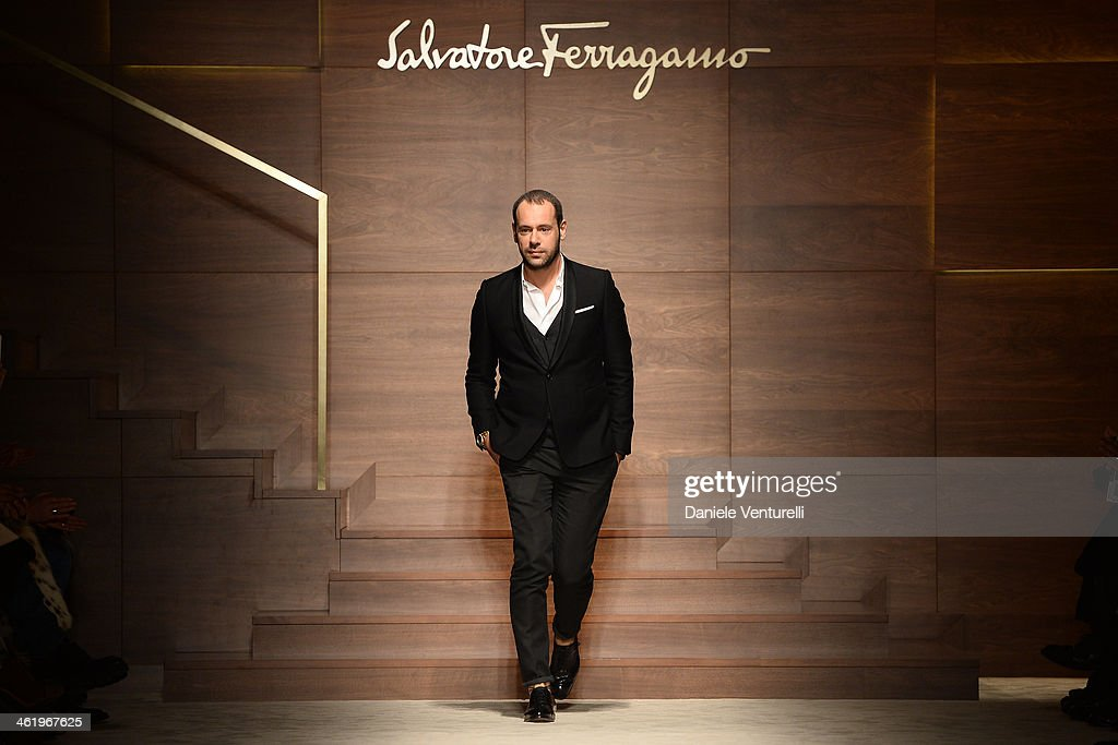 Italian designer <a gi-track='captionPersonalityLinkClicked' href=/galleries/search?phrase=Massimiliano+Giornetti&family=editorial&specificpeople=3951751 ng-click='$event.stopPropagation()'>Massimiliano Giornetti</a> acknowledges the applause of the public after the Salvatore Ferragamo show as a part of Milan Fashion Week Menswear Autumn/Winter 2014 on January 12, 2014 in Milan, Italy.
