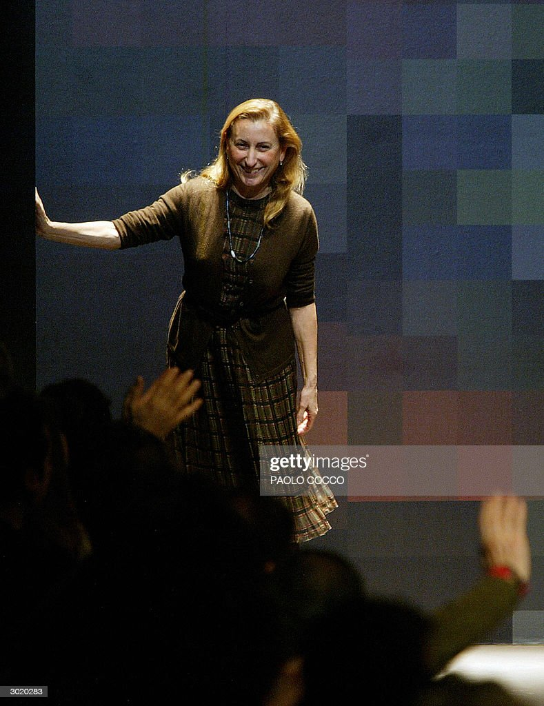 Italian designer Miuccia Prada acknowledges applauses on the catwalk at the end of her Miu Miu's autumn/winter 2004-2005 women's collection, 27 February 2004 during the Milan's fashion week. AFP PHOTO/Paolo COCCO