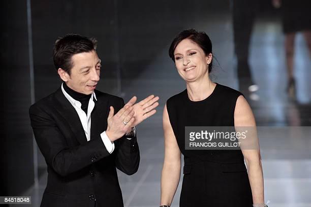 Italian designers Maria Grazia Chiuri and Pier Paolo Piccioli for Valentino acknowledge teh public after a Spring/Summer 2009 Haute Couture...